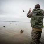 Guide Josh Fitz tossing the decoys out